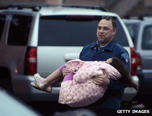 A little girl is carried to safety in Watertown, 19 April