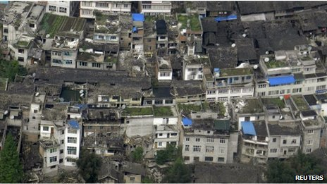 An aerial view shows houses damaged after a strong earthquake in Lushan county, April 20, 2013
