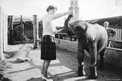 The Farrars' secretary, Joan Honisett, playing with a baby elephant at Southport Zoo in the early 1960s