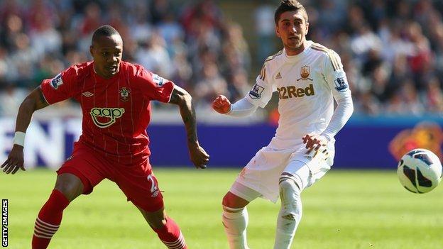 Southampton's Nathaniel Clyne and Swansea's Pablo Hernandez