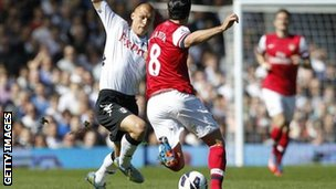 Steve Sidwell (left) makes the challenge on Mikel Arteta that led to his red card against Arsenal