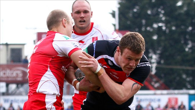 St Helens' Josh Jones tackled by Hull KR's Michael Dobson