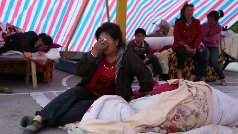 Earthquake survivors rest in a tent in Gonghe, near Ya'an, China 21 April