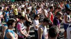 Runners stand in a silent tribute to the victims of the Boston Marathon bombings before the start of the London Marathon