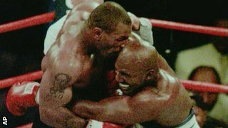 Mike Tyson in a clinch with Evander Holyfield, 1997