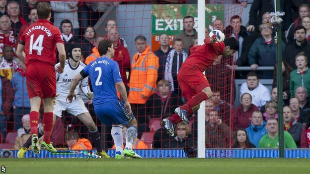 Liverpool striker Luis Suarez heads in an equaliser against Chelsea