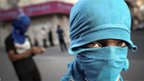 A masked protester against the Bahraini regime