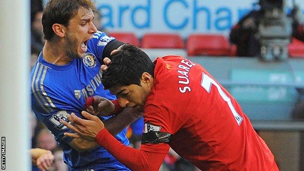 Luis Suarez tangles with Branislav Ivanovic