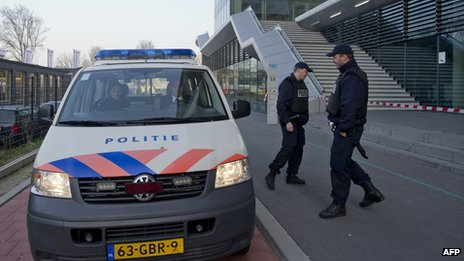 Dutch police stand outside the Da Vinci College in Leiden on 22 April 2013