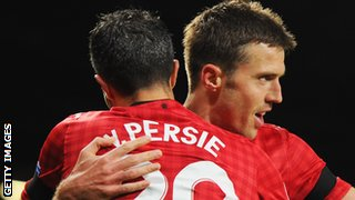 Robin van Persie and Michael Carrick