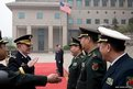 U.S. Joint Chiefs Chairman General Martin Dempsey (2nd L) salutes in Beijing