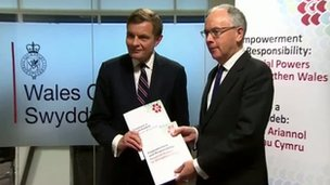 Paul Silk presents his report to Welsh Secretary David Jones