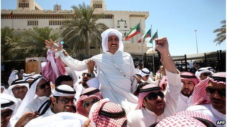 Mussallam al-Barrak, held aloft by supporters outside court in Kuwait city (22/04/13)