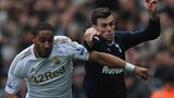Swansea's Ashley Williams in Premier League action against Tottenham's Gareth Bale