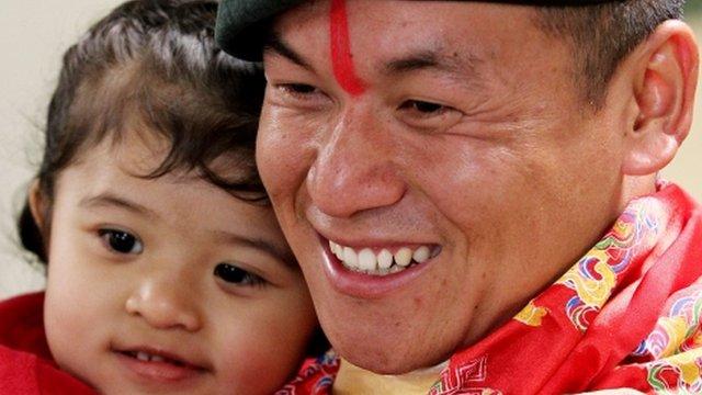 L/Cpl Ratan Raj Rai is hugged by his three-year-old daughter Rayana