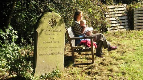 Woman and baby in churchyard
