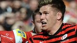 Saracens fly-half Owen Farrell takes on the Gloucester defence