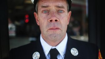 Medford Fire Department Captain Tom Brennan poses after attending the funeral of Krystle Campbell, 22 April