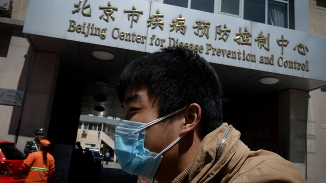 A Chinese man arrives at the Beijing Centre for Disease Prevention and Control as the country deals with the H7N9 bird flu virus