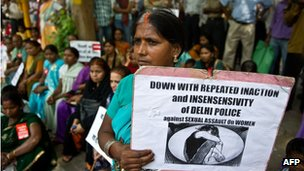 An Indian woman holds a placard during a protest against the rape of a five-year old girl in New Delhi on April 22, 2013.