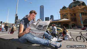 A man reading a newspaper in Melbourne