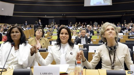 "Three Cuban ""Ladies in White"", Laura Maria Labrada Pollan, Belkis Cantillo Ramirez and Elena Larrinaga hold hands at the European Parliament in Brussels"
