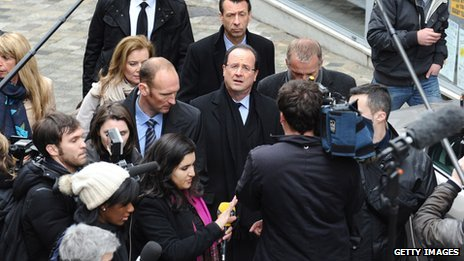 Francois Hollande in the middle of a media scrum