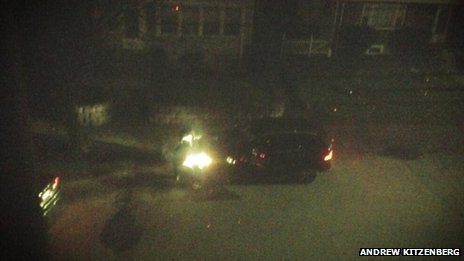 Image of bomb suspects Tamerlan and Dzhokhar Tsarnaev in a gun battle with police on Laurel St, Watertown, in the early hours of 19 April - image courtesy Andrew Kitzenberg
