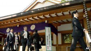 A group of Japanese lawmakers leave after they offered prayers at the Yasukuni Shrine in Tokyo during an annual spring festival on 23 April 2013