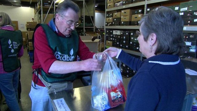 Woman donating to food bank