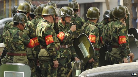 Security personnel in Urumqi, capital of China's Xinjiang region (July 2010)