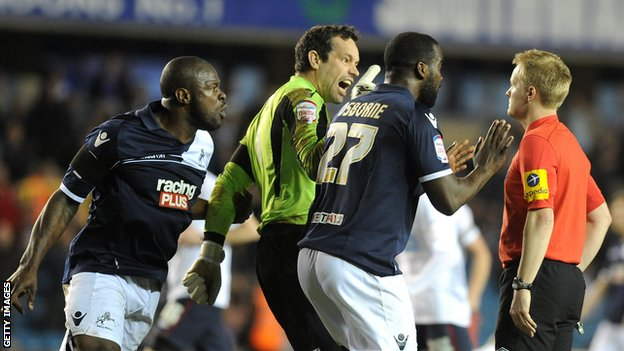 Millwall's Danny Shittu, David Forde and Karleigh Osborne remonstrate with Gavin Ward
