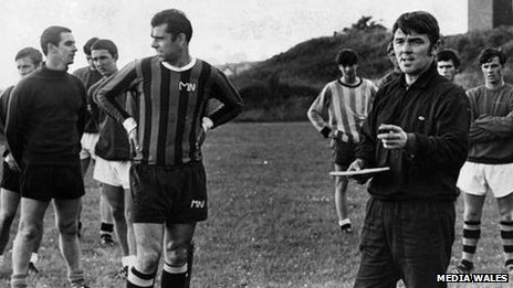 Harry Griffiths instructs the Swansea City team in training