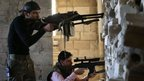 Free Syrian Army fighters take their positions in Idlib province on 26 February