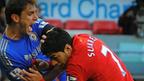 Liverpool's Luis Suarez bites Chelsea's Branislav Ivanovic