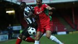 Grimsby's Cleveland Taylor and Newport Andy Sandell battle for the ball