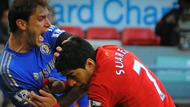 Liverpool's Luis Suarez bites Chelsea's Branislav Ivanovic