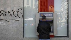 Bank with graffiti on wall
