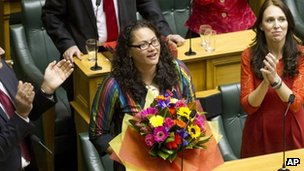 New Zealand lawmaker Louisa Wall, centre, who sponsored the gay marriage bill is congratulated by Labour leader Davis Shearer, left, and MP Jacinda Ardern after the Marriage Amendment Bill was passed at Parliament in Wellington, New Zealand Wednesday, 17 April 2013