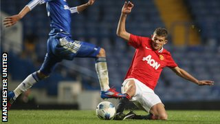 Nicholas Ioannou of Manchester United Academy Under-18s clashes with Alex Kiwomya of Chelsea Academy Under-18s