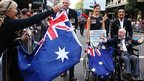 An Australian war veteran waves at a bystander during the Anzac Day parade in Sydney (25 April 2013)