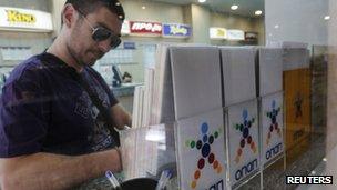 Man handing in Opap lottery form
