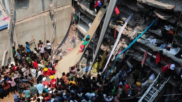 Volunteers attempt to rescue workers after a building in Bangladesh  collapses