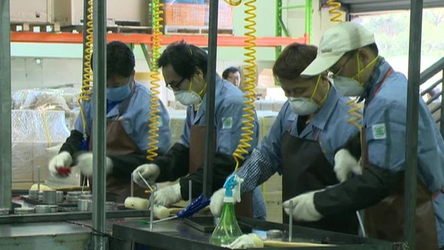 Workers at a makeshift factory in South Korea
