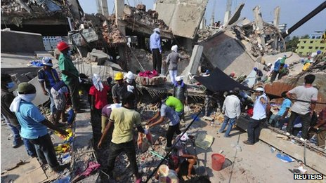 Rescue workers search for trapped garment workers among the rubble of the collapsed Rana Plaza building