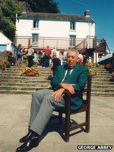 George Abbey outside The Boathouse in laugharne