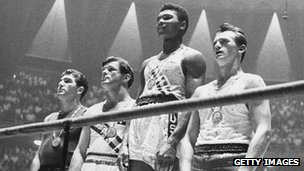 The 1960 Olympic medals for light heavyweight boxing on the winners' podium at Rome