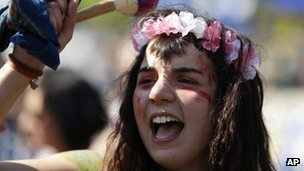 A young woman taking part in a march celebrating the 1974 revolution, on April 25 in Lisbon