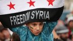 A boy holds a banner saying &quot;Freedom Syria&quot; in Amman, Jordan