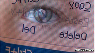 Eye reflected in computer screen